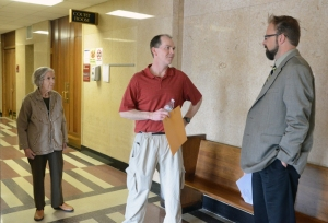 The Schulzes confer with attorney Ludwig after the hearing.