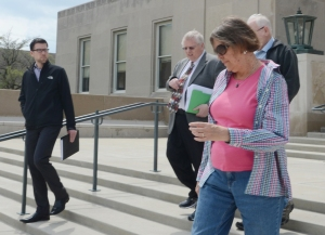 Village Administrator Michael Hawes, Bruner, Van Lone, and Britton leave the courthouse after the hearing.