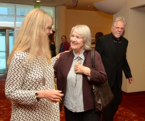 Dixie Legler Guerrero, left, greets Effi Casey. Tim Wright, Frank Lloyd Wright's grandson, is at right.