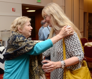 Minerva Montooth, left, and Dixie Legler Guerrero chat at the reception after the screening.