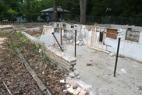 This is the foundation of the Frank Lloyd Wright - designed Sherman Booth Cottage (1913) which was moved to its new home in a park about one tenth of a mile away in suburban Glencoe, Illinois Tuesday July 21, 2020. The cottage was threatened with demolition by the new owners of the lot it has stood on since 1916. With the help of the Frank Lloyd Wright Building Conservancy, the nonprofit Glencoe Historical Society acquired the home and hopes to remodel it and turn it into a museum and research center. The diminutive home, built for Wright's attorney Sherman Booth while his larger Wright home was being built nearby, is said by some Wright aficionados to be a precursor to his post-1936 Usonian home designs. There are five other Wright homes in the nearby Ravine Bluffs neighborhood.